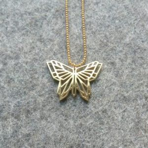 origami-butterfly-pendant-gold-on-felt-b