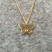 Origami Small Butterfly pendant on felt