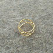 Three circles ring gold on felt