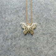 Origami Butterfly Pendant gold on felt b