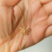 Origami Small Butterfly pendant in hand