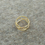 Three circles ring gold on felt
