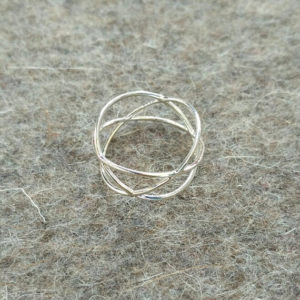 Three circles ring silver on felt