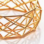 Constrcutionist Bracelet brass op wit dichtbij closeup 620x421