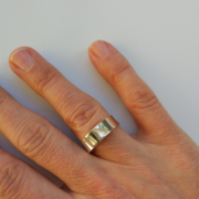 Folds ring on hand above