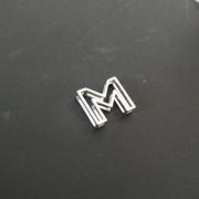 Letter M on black 2